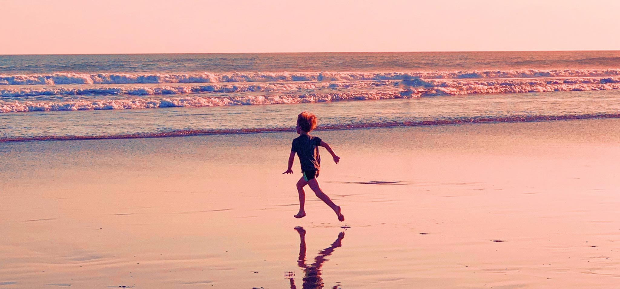 Kid running on the beach